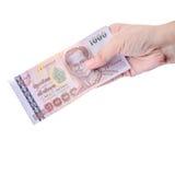 Hand holding Thai money isolated Royalty Free Stock Image