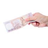 Hand holding Thai money isolated Stock Photography