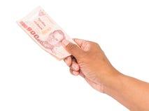 Hand holding thai money Royalty Free Stock Photography