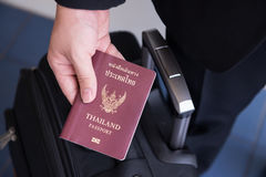 Hand holding Thai passport, ready to travel Royalty Free Stock Images