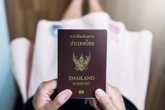 Hand holding Thailand passport. Close up stock image