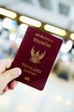 Hand holding thailand passport Stock Images
