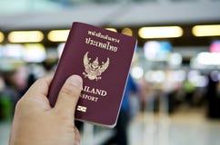 Hand holding thailand passport Stock Image