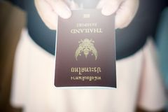 Hand holding Thailand passport. Close up royalty free stock photo