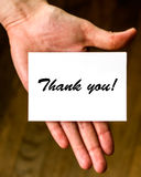 Thank you!. Hand holding a thank you note. Ideal to be included at the end of a presentation Royalty Free Stock Image