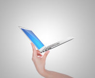 Hand holding thin laptop Royalty Free Stock Image