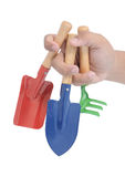 Hand holding three garden tools Royalty Free Stock Image