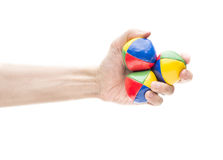 Hand holding three juggling balls Royalty Free Stock Images