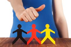 Hand holding thumb up at paper chain people Stock Images