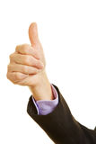 Hand holding thumb up Stock Images