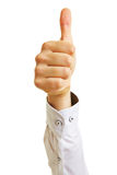 Hand holding thumbs up Stock Images