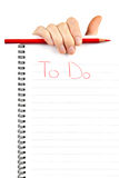 Hand holding to do list. Paper note and red pencil Royalty Free Stock Photography