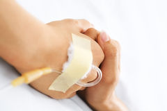 Hand holding together in hospital. That injected in IV Stock Image
