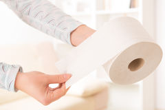 Hand holding toilet paper Stock Photos
