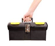 Hand holding toolbox Stock Photo