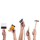 Hand holding tools Royalty Free Stock Photos