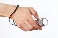 Hand holding a torchlight on white background Stock Images