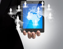 Hand holding a touch pad. Show Earth and social network Stock Photos