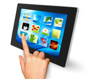 Hand holding touch pad pc and finger. Touching it's screen with icons. Vector Stock Images