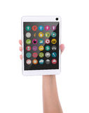 Hand holding touch screen device with colorful application icons Royalty Free Stock Photography