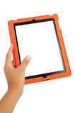 Hand holding the touch screen tablet. With white screen and orange case Stock Photo