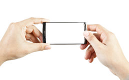Hand holding and touch smart phone Royalty Free Stock Photography