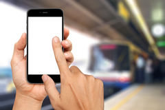 Hand are holding and touch Smartphone with sky train Stock Photography