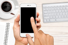 hand holding and touch on white smartphone with blank screen Royalty Free Stock Photos
