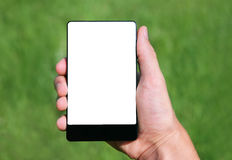 Hand holding touchscreen smart phone. On green background Stock Images