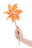 Hand holding toy pinwheel Royalty Free Stock Photo
