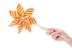 Hand holding toy pinwheel. Hand holding colorful toy pinwheel on white background Stock Image