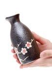 Hand holding traditional sake bottle Stock Photography