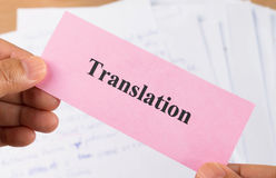 Hand holding translation card Stock Photo