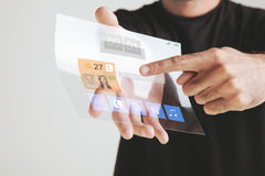 Hand holding transparent future tablet made of graphene. Concept. Royalty Free Stock Image