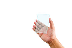 Hand holding transparent plastic device Royalty Free Stock Images