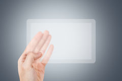 Hand Holding Transparent Tablet Royalty Free Stock Photo