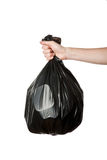 Hand holding trash bag Stock Photography
