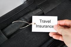 Hand holding travel insurance tag Stock Images