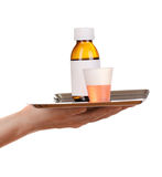 Hand holding tray with medicines Stock Photography