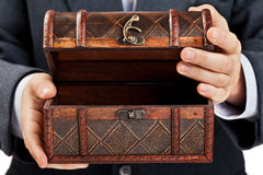 Hand holding treasure chest Royalty Free Stock Photography