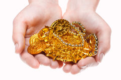 Hand holding treasures Stock Image