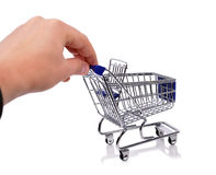 Hand holding trolley Stock Images