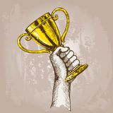 Hand holding trophy Stock Photography