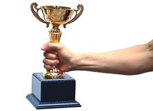 Hand holding a trophy. Representing victory stock images