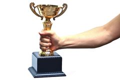 Hand holding a trophy. Representing victory royalty free stock photography