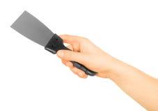 Hand holding trowel Stock Image
