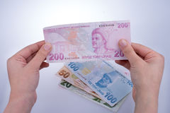 Hand holding Turksh Lira banknote in hand Royalty Free Stock Photography
