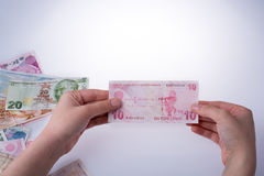 Hand holding Turksh Lira banknote  in hand Royalty Free Stock Photo