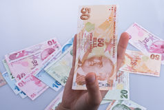 Hand holding Turksh Lira banknote  in hand Royalty Free Stock Image