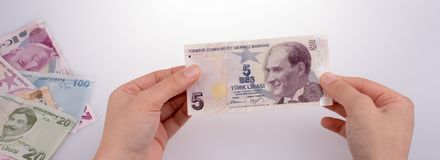 Hand holding Turksh Lira banknote  in hand Stock Photography